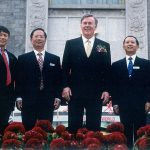 Pat and Hugo Shong with CCW's managment team at a celebration marking the JV's 20th anniversary in 2000.